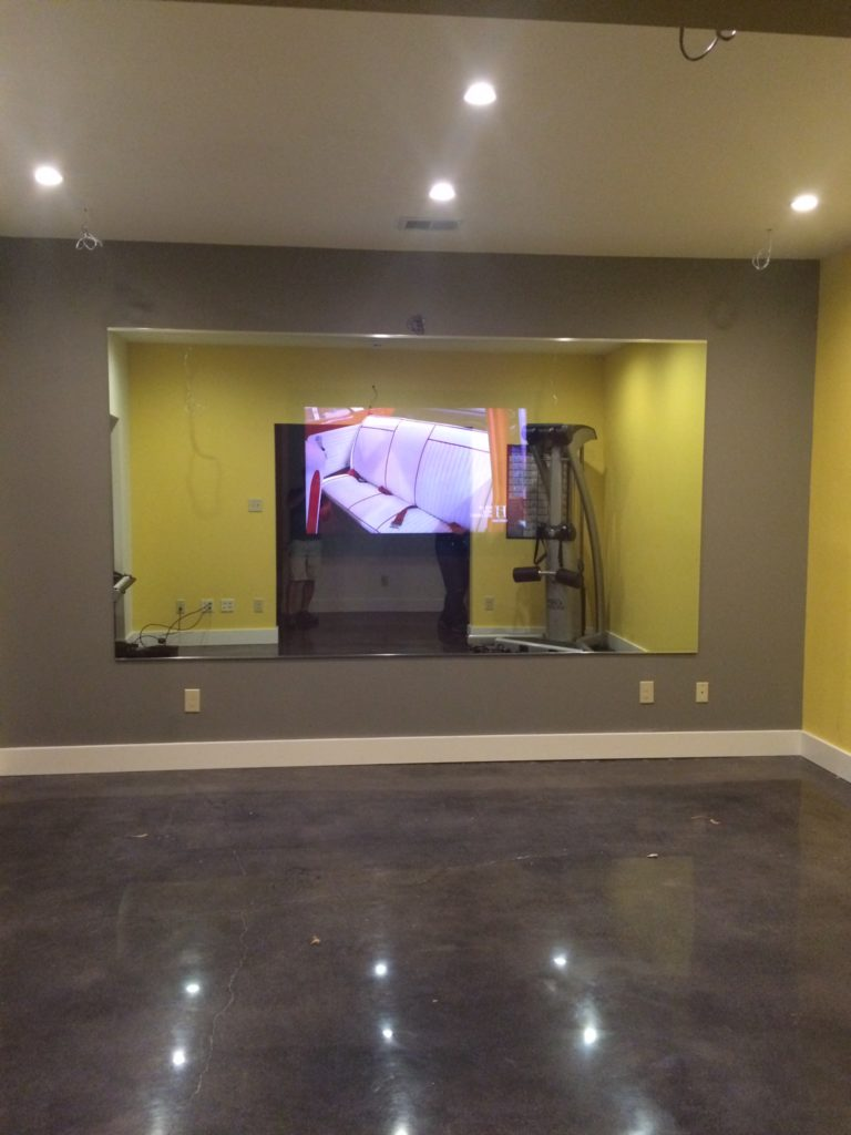 Large Floating Gym Mirror with Hidden TV Display Behind Panel