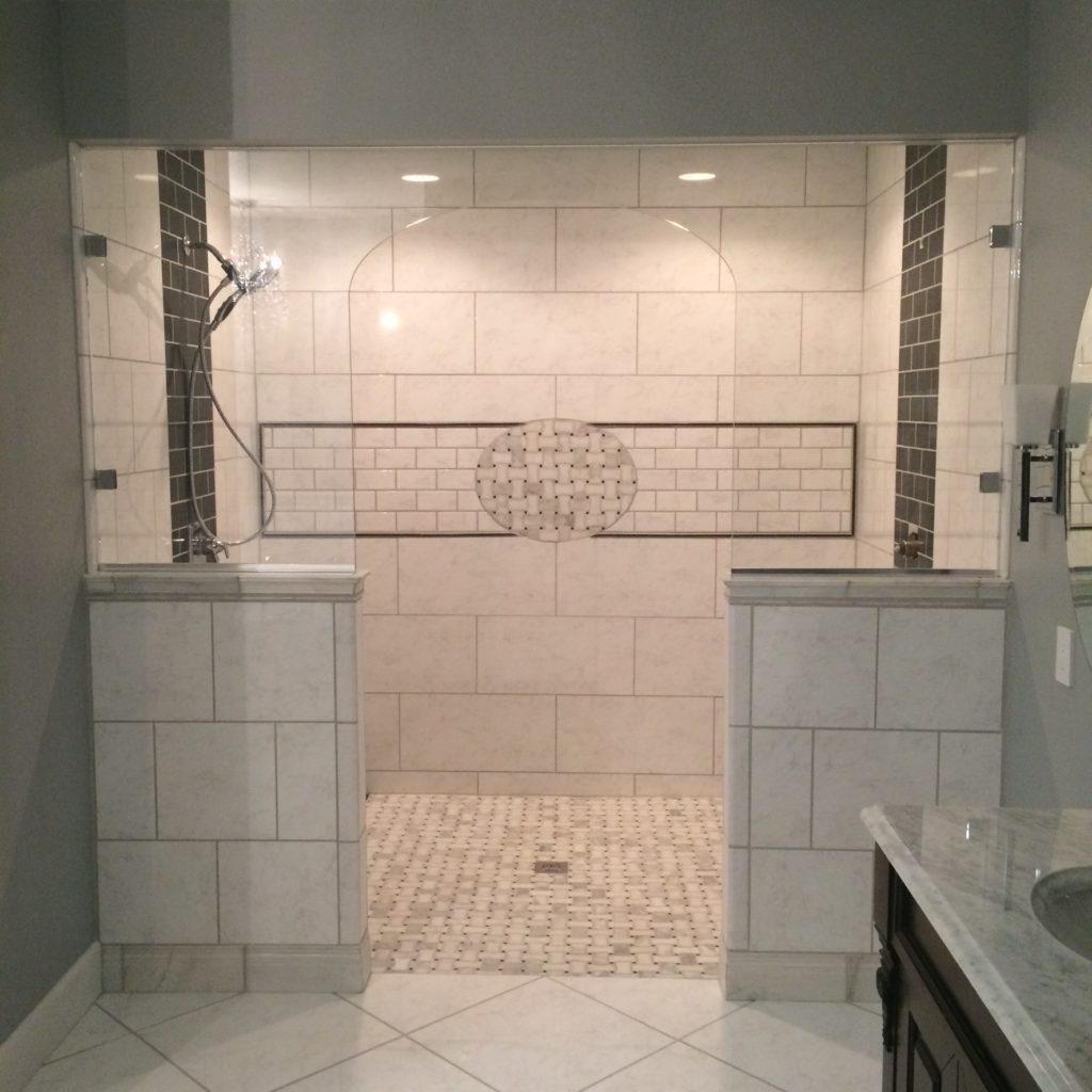 Frameless Glass Shower - Ultra Clear Glass. Do you notice the arched cutout in the glass?
