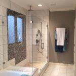 Frameless Ultra Clear Glass Shower With 90 Degree Panel On Bathtub Riser