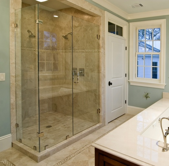 Frameless Glass Shower Enclosure with Chrome Hardware and Showerguard