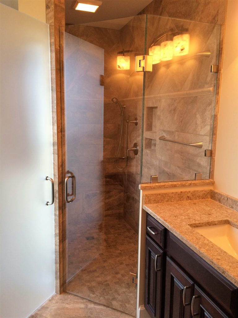 Angled Swingdoor Shower Enclosure with Offset Half Wall Panel
