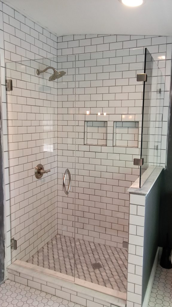Frameless Glass Shower Enclosure with Showerguard and 90 Degree Off-Set Half Wall Panel