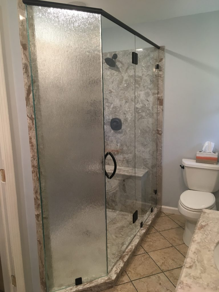 Ultra Clear Shower Enclosure with 90 Degree Off-Set Rain Patterned Panel and Oil Rubbed Bronze Header Bar