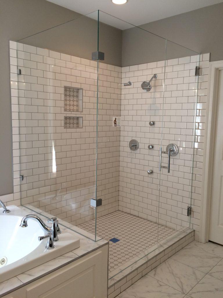Ultra Clear Frameless Glass Shower With 90 Degree Panel On Bathtub Riser