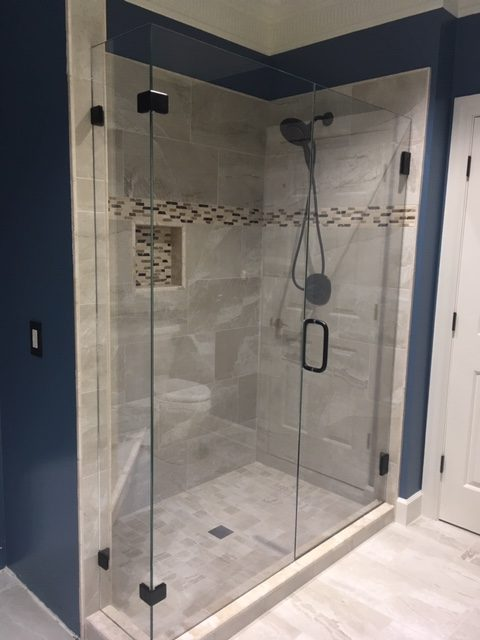 In-Line Frameless Glass Shower With Off-Set 90 Degree Glass-to-Glass Clamps