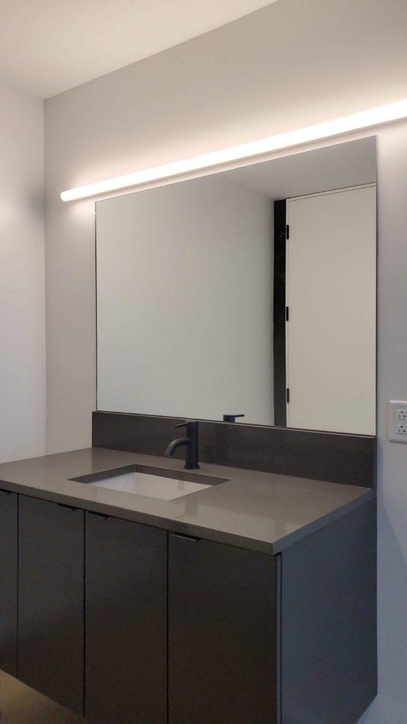 Ultra-Modern Flat Polished Vanity Mirror in Dance Studio Bathroom